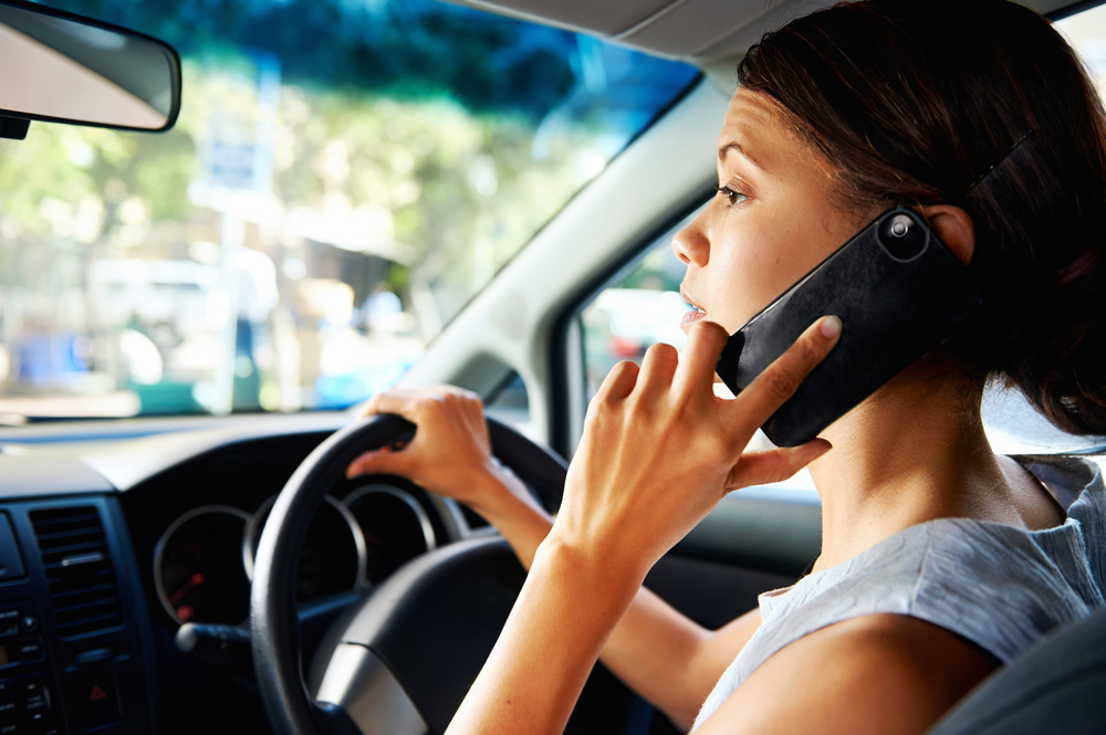 woman talking on the cell phone while driving
